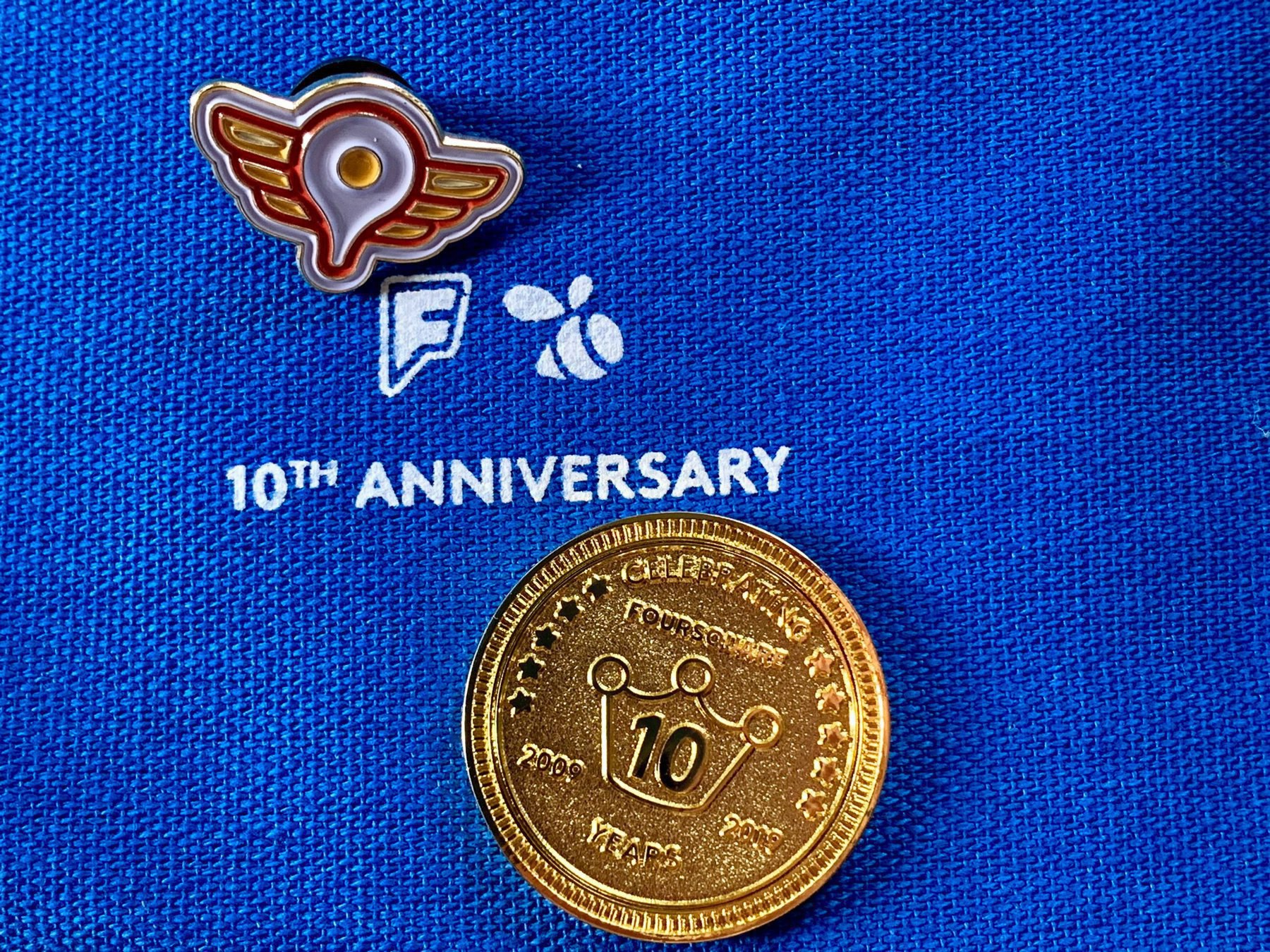 Foursquare 10th anniversary coin and superuser pin
